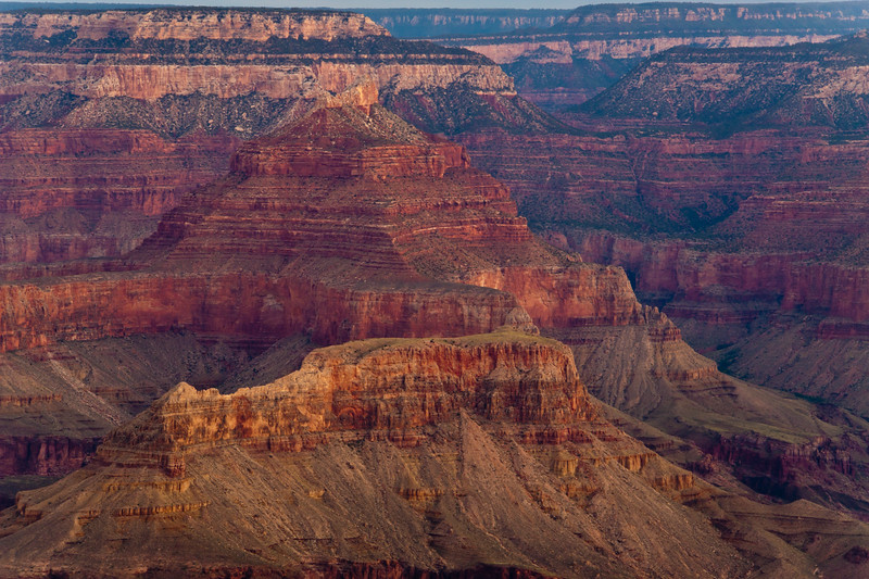 """Sunrise on the South Rim of the Grand Canyon National Park in Arizona. Grand Canyon is a geological wonder, with rock layers serving as """"windows into time."""" It represents an estimated time period of over 2 billion years, formed by colliding land masses, mountains formed and then eroded over millions of years, and the incredible force of moving water. Grand Canyon was granted National Park status in 1919."""