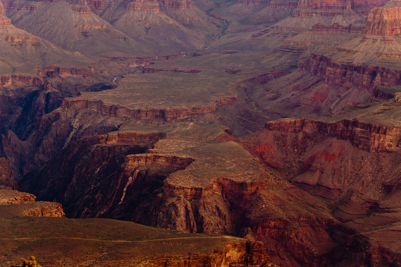 "Sunrise on the South Rim of the Grand Canyon National Park in Arizona. Grand Canyon is a geological wonder, with rock layers serving as ""windows into time."" It represents an estimated time period of over 2 billion years, formed by colliding land masses, mountains formed and then eroded over millions of years, and the incredible force of moving water. Grand Canyon was granted National Park status in 1919."