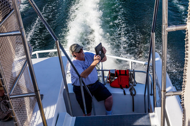 Lake Powell tourist taking photo with iPad camera.