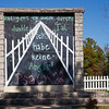"""At the Christ of the Ozarks complex in Eureka Springs, Arkansas, an original ten-foot by ten-foot section of the Berlin Wall was erected next to the Church in the Grove. An East Berliner painted these words from the 23rd Psalm in German on the wall, """"Though I walk through the dark valley, I will not fear."""" When the wall came down, The Great Passion Play acquired this piece."""