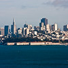 "Skyline of San Francisco, California, across San Francisco Bay, viewed from north end of the Golden Gate Bridge. San Francisco is famous in song and stories as the ""City by the Bay."""