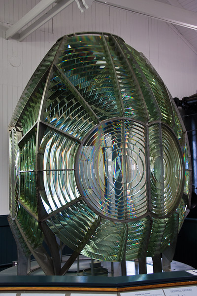 First Order Fresnel Lens in museum at Point Arena Lighthouse on the pacific coast in northern California. The original lighthouse was completd in 1870 and a first order lens was installed. After an earthquake in 1906 destroyed tower and lens, a new, 115 foot concrete-reinforced lighthouse was built and this new first order Fresnel lens was installed. The lighthouse was automated in  1977.