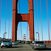 Viewpoint from car crossing the Golden Gate Bridge in San Francisco, California. Linking San Francisco with Marin County across San Francisco Bay, the Golden Gate Bridge is a 1.7 mile-long suspension bridge that can be crossed by car, on bicycles or on foot. There are parking and viewing areas at either end of the bridge.