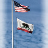 US flag and California Republic Flag at San Diego Old Town State Park.