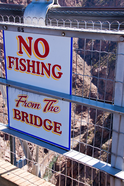 """No Fishing"" Sign on the Royal Gorge Suspension Bridge in Colorado. This bridge over the Arkansas River is the world's highest suspension bridge hanging 1053 feet above the river."