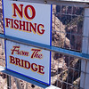 """""""No Fishing"""" Sign on the Royal Gorge Suspension Bridge in Colorado. This bridge over the Arkansas River is the world's highest suspension bridge hanging 1053 feet above the river."""