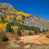 Autumn color at Red Mountain Creek on the Million Dollar Highway (US 550) portion of the San Juan Skyway Scenic Byway in Colorado. The San Juan Skyway is an incredibly beautiful loop of designated Colorado State Highways covering 236 miles in Southwest Colorado.