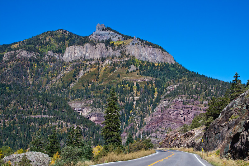 Steep and cliff-hugging Million Dollar Highway (US 550) near Red Mountain Pass, a portion of the San Juan Skyway Scenic Byway in Colorado. The San Juan Skyway is an incredibly beautiful loop of designated Colorado State Highways covering 236 miles in Southwest Colorado.