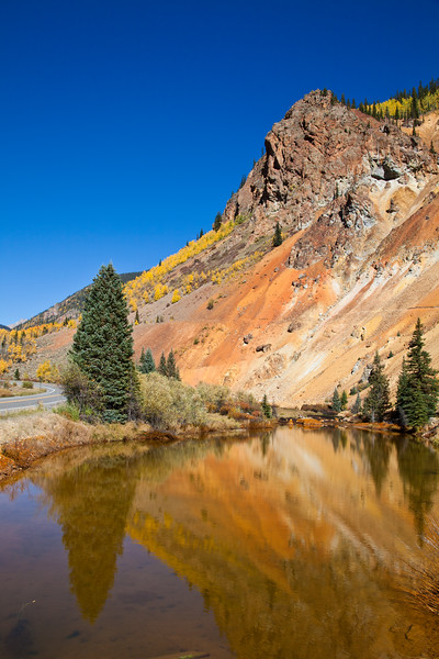 Reflections in lake with autumn color just north of Silverton, along the Million Dollar Highway (US 550) portion of the San Juan Skyway Scenic Byway in Colorado. The San Juan Skyway is an incredibly beautiful loop of designated Colorado State Highways covering 236 miles in Southwest Colorado.