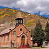 St Patrick Catholic Church is one of the colorful historic buidlings in the old mining town of Silverton, Colorado, which is a designated National Historic Landmark District. The town is presently completely dependent on tourism.