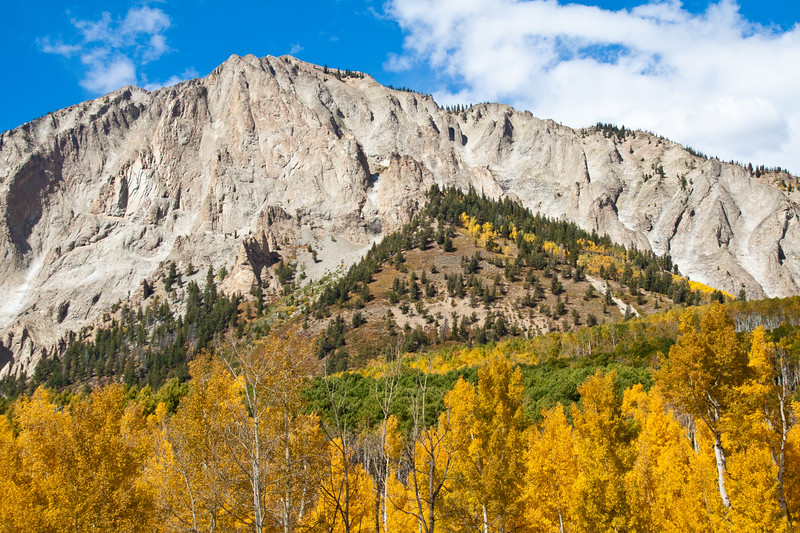 Autumn Color at Marcellina Mountain with Aspens turning - on Kebler Pass road (officially named GCR12 or Gunnison County Road 12) west of Crested Butte, Colorado.  The summit of Kebler Pass is 10007 feet and most of the road is dirt and is closed in winter.