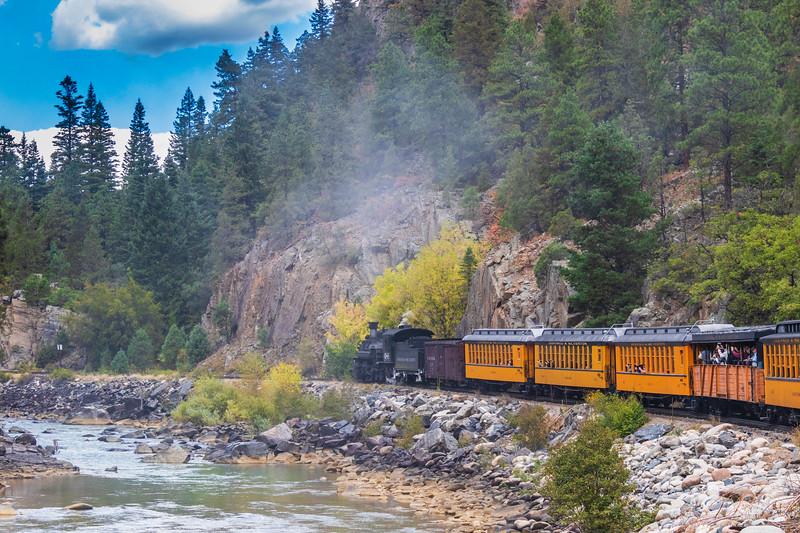 Durango and Silverton Narrow Gauge Railroad tourist train ride in autumn through the San Juan Mountains and the San Juan National Forest.