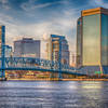 Panorama of sunset on buildings of downtown Jacksonville, Florida on St Johns River.