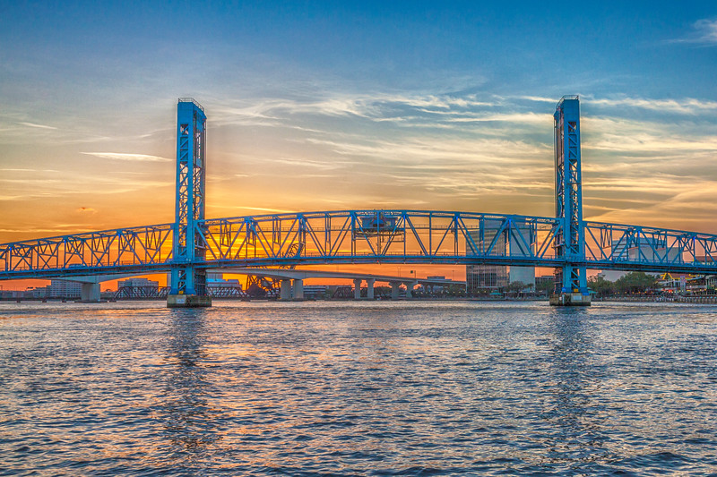 Sunset on downtown buildings and bridges on St Johns River in downtown Jacksonville, Florida.