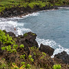 Black sand beach and crashing waves at Waianapanapa Park on Maui, at mile marker 32 on the Road to Hana.