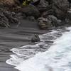 Black sand beach at Waianapanapa Park at mile marker 32 on the Road to Hana on the island of Maui in Hawaii.
