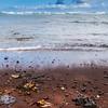 Kaihalulu Red Sand Beach near the village of Hana on the famous Road to Hana on the island of Maui in Hawaii.