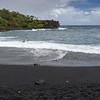 Black sand beach and crashing waves at Waianapanapa Park on Maui, at mile marker 32 on the Road to Hana.