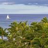 Catamaran Sailboat in Pacific ocean on the coastline of Oahu in Hawaii.
