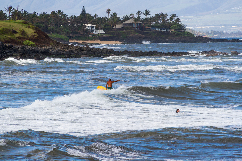 Surfers at Ho`okipa Beach Park. First stop on Road to Hana tour, Ho`okipa Beach Park is famous for surfers and white sand beaches.