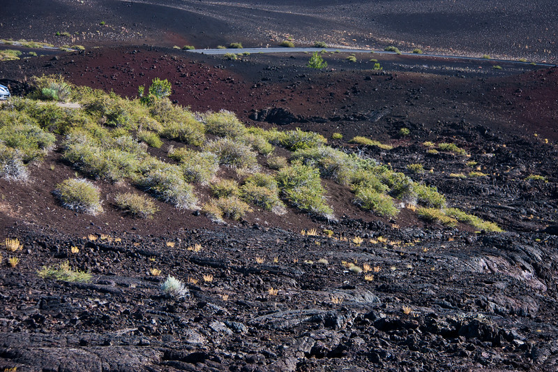 """Rugged Terrain in Craters of the Moon National Monument and Preserve in Idaho. The National Park Service describes the park as """"a vast ocean of lava flows with scattered islands of cinder cones and sagebrush."""" Early NASA astronauts trained here because of the terrain."""