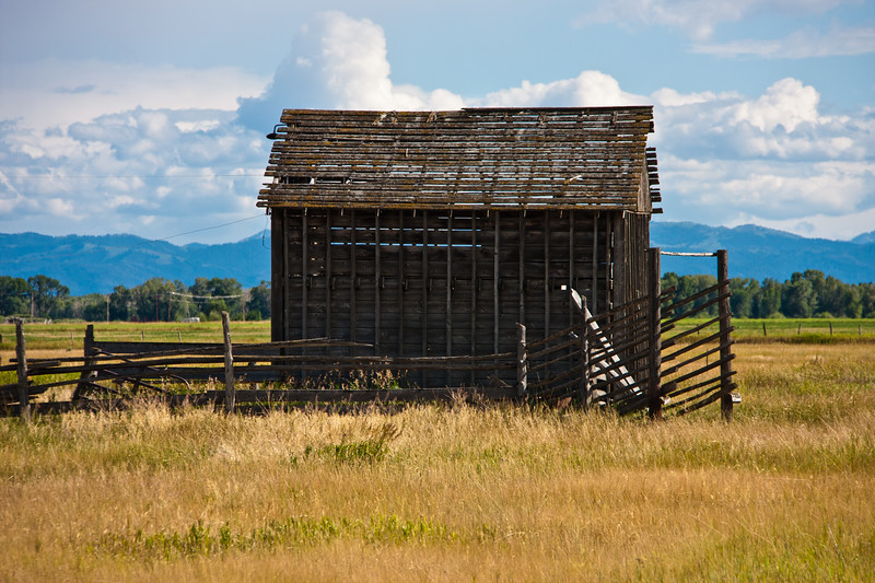 Abandoned barn on Idaho farm in the Teton valley, on the western side of the Teton mountain range.