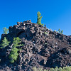 "Rugged Terrain in Craters of the Moon National Monument and Preserve in Idaho. The National Park Service describes the park as ""a vast ocean of lava flows with scattered islands of cinder cones and sagebrush."" Early NASA astronauts trained here because of the terrain."