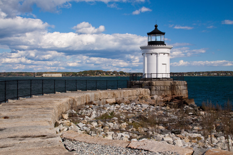 Portland Breakwater Lighthouse, in Portland, Maine, is located in city park called Bug Light Park. The Portland Breakwater, built in 1831 in reaction to a destructive storm, helped to protect the harbor, but was difficult for mariners to see. The Portland Breakwater Light, only 26 feet tall, was built in 1855 to warn mariners of the presence of the Breakwater Ledge in Portland Harbor at Casco Bay, at the mouth of the Fore River. The light was extinguished in 1942, but was relit in 2002.