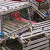 Lobster traps on display at a tourist restaurant near Pemaquid Point Lighthouse in Maine.