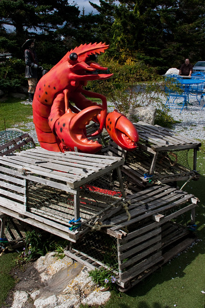 Lobster statue on Lobster traps at a restaurant near Pemaquid Point Lighthouse in Maine.