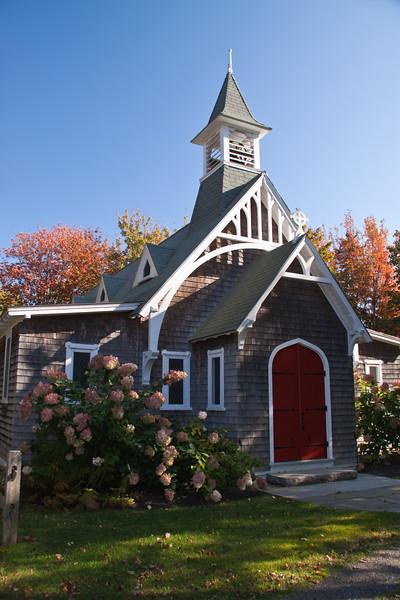 Autumn color at country church or chapel on Bailey Island, near Mackerel Cove, on the Atlantic Coast of Maine.