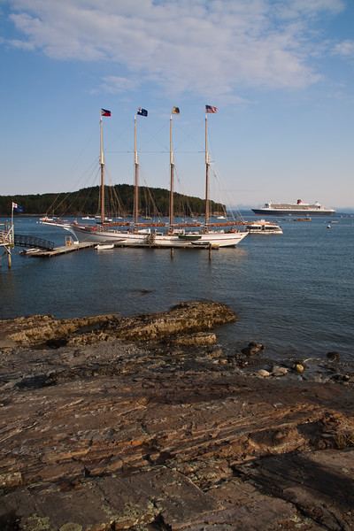 Tall Ships or Four-masted Schooners in Bar Harbor, on Mount Desert Island, Maine. Bar Harbor is considered a playground of the wealthy and often hosts tall masted sailing ships, cruise ships, yachts, tour boats, and fishing boats as well.