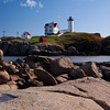 "Cape Neddick Lighthouse, also known as York Lighthouse and as the ""Nubble Light,"" is located near the old colonial town of York, Maine, on a small, barren island locally known as ""Nubble"" island. This island is just off Cape Neddick on the Atlantic Coast of Maine. The lighthouse was established in 1879. It is an active light, still depending on a fourth-order Fresnel lens, and flashing red every 6 seconds to warn mariners of the dangers of this rocky outcropping. It is an extraordinarily beautiful lighthouse wtih a lovely wood-frame keeper's quarters building. The lighthouse can be viewed from a park called Sophier Park at the end of Cape Neddick."