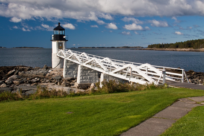 Marshall Point Lighthouse and museum at Point Clyde, Maine, is both a picturesque site and an educational opportunity which is open to the public from May through October. The lighthouse was built in 1832, and rebuilt in 1858, but now has a modern optic visible for 7 miles, and serves as a lighthouse museum as well. It is managed by the St. George Historical Society.