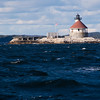 """Cuckolds Lighthouse, on the Atlantic coast of Maine, is located on the """"Cuckolds"""" - which according to the 1891 Maine Lighthouse Board """"consists of two rocky islets rising about 15 feet above high water in the westerly edge of the channel at Booth Bay.""""<br /> The station had to be constructed such that it could withstand tremendous forces, and the keepers on this station were often involved in rescuing shipwrecked mariners in spite of the presence of the light."""