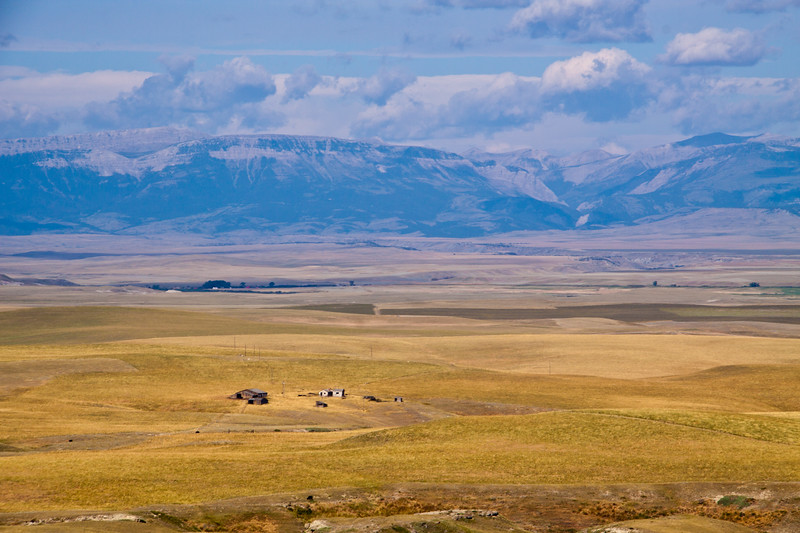 Grasslands and Montana hay farming and ranching with the Rocky Mountain Front just south of Glacier National Park in Montana.