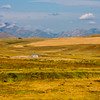 With the Flathead Mountain Range for a backdrop, large scale grain farming and cattle ranching on the almost treeless high plains of Montana create vistas that seem to go on uninterrrupted as far as the eye can see.