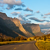 Sunrise lighting the mountains along Going to the Sun Road in Glacier National Park in Montana.