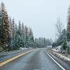 Scenic drive in ice and snow on US 93 through Flathead National Forest in northwestern Montana in late October.