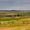 Large scale grain farming and cattle ranching on the almost treeless high plains of Montana creates vistas that seem to go on uninterrrupted as far as the eye can see.