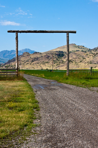 Entrance to Montana farm along scenic US highway 89 in a valley between the Gallatin Mountain Range on the west and the Absaroka Mountain Range on the east.