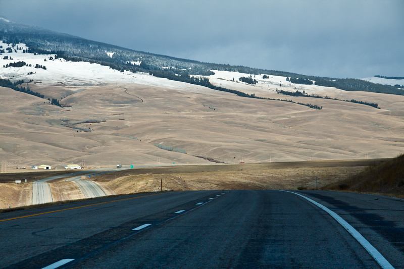Driving in Snow and Ice on scenic highway Interstate 15 in southwesten Montana in late October, with the snow-covered Pioneer mountains in the distance.