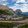 Logan Pass visitor center In Glacier National Park in Montana. Logan Pass Visitor Information Center is at the summit of Going to the Sun Road at an elevation of 6,700 feet and straddles the Continental Divide. The Visitor Center is open mid-June to mid-September.