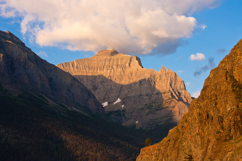 Early morning sun on mountains in eastern part of Glacier National Park in Montana.