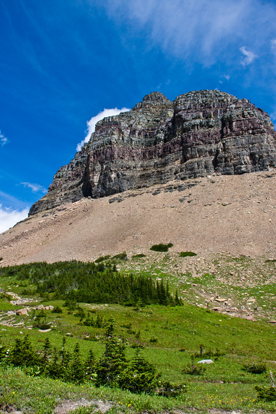 Piegan Mountain at Logan's Pass area in Glacier National Park in Montana. Piegan Mountain (9,220 feet (2,810 m)) is located in the Lewis Mountain Range, part of the Rocky Mountain Front, Piegan Glacier is located in a cirque immediately southeast of the summit.
