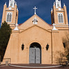 San Felipe de Neri Church, located in Old Town Albuquerque, the serene village that has been the focal point of Albuquerque community life since 1706. Quiet hidden patios, winding brick paths, gardens and balconies are intersperse with wrought iron and adobe benches which beckon you to rest in the shade and watch people stroll by. Historic San Felipe de Neri Church and with its Rose Garden is the centerpiece of the Old Town Square.