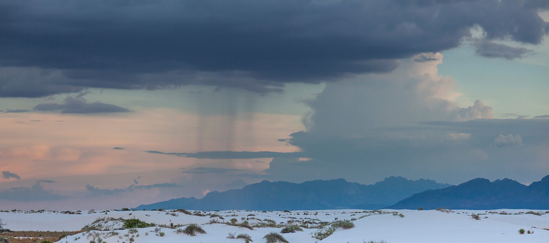 Rain storm in distance viewed from Ranger guided sunset walk at White Sands National Monument in New Mexico