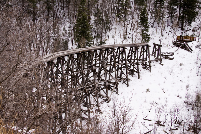 Snow on abandoned train tracks along Highway 82 between Alamogorda and Cloudcroft , New Mexico. Highway 82 is steep and winding scenic drive.
