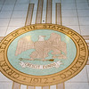Great Seal of the State of New Mexico on floor of Capitol Building. Motto is Latin - Crescit Eundo. (It grows as it goes).