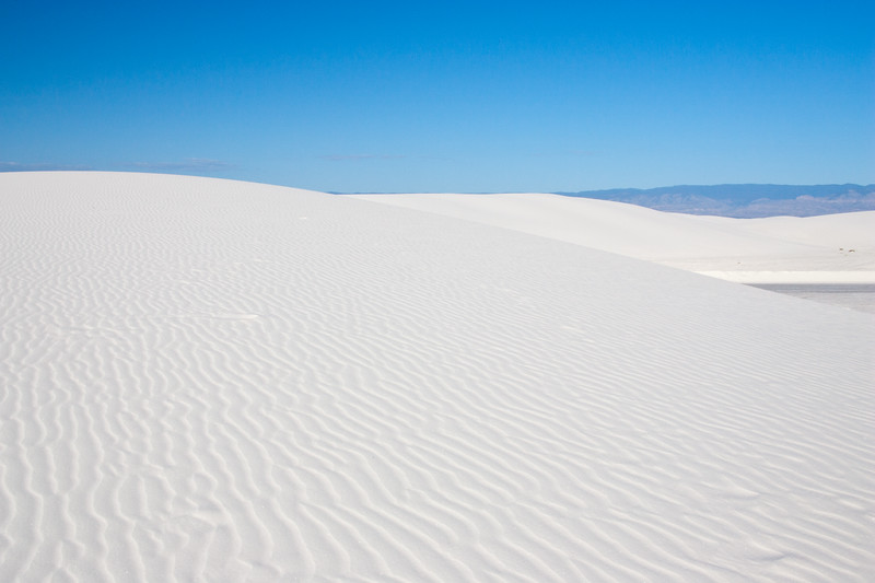 White Sands National Monument is a United States National Monument/Park that is in the southeastern region of the state of New Mexico. The monument contains the world's largest gypsum sand dune field -- 275 square miles of fine white sand, formed by the prevailing winds into large ridge-like dunes.